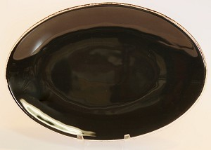 "7"" x 10"" Oval Black Glass Plate, Bent."