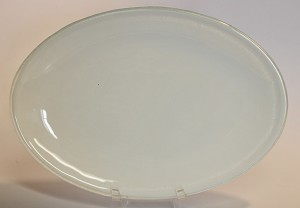 "7"" x 10"" Oval White Glass Plate, Bent."